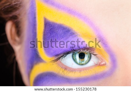 portrait of a young woman with fantasy makeup - stock photo