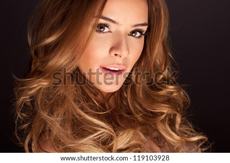 Portrait of a young woman with perfect makeup - stock photo