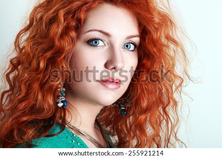 Portrait of a young woman with red hair and blue eyes - stock photo