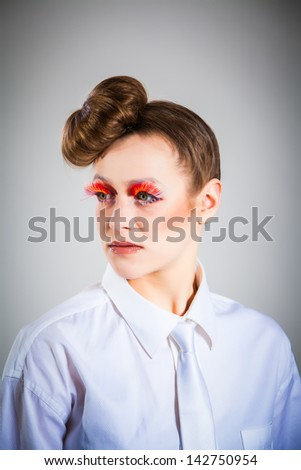 portrait of a young woman with strict hairstyle in front of white ...