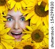 Portrait of a young woman with sunflowers - stock photo