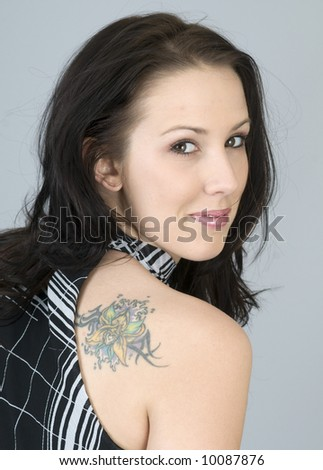 Portrait of a young woman with tattoo