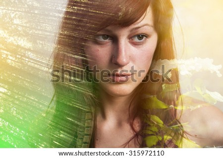Portrait of a young woman with the effect of double exposure, nature style