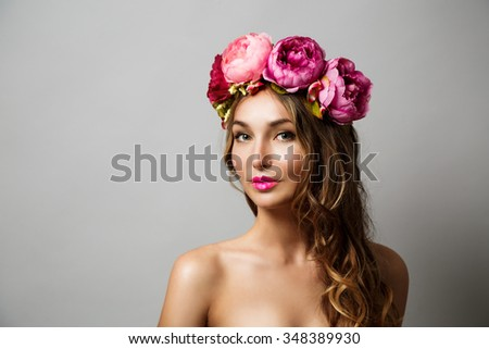 Portrait of a Young Woman with Wreath of Pink Flowers on Gray Background. Natural Beauty Concept. Copy Space.