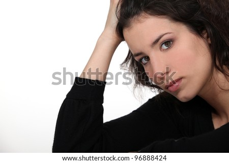 Portrait of a young woman worried - stock photo