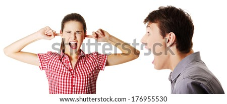 Portrait of a young women gets earful from an annoyed men against white background