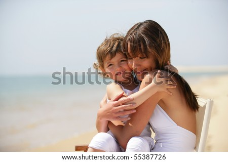 Portrait of a young women with a little girl in her arms - stock photo