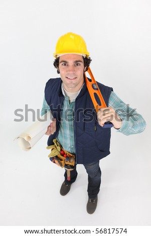 Portrait of a young worker holding plans on white background - stock photo