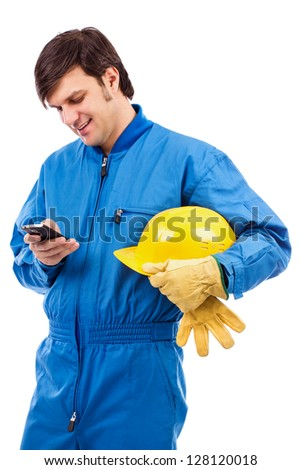 Portrait of a young worker using mobile phone isolated on white background - stock photo