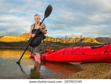 Portrait of Active Senior Man with his Kayak - stock photo
