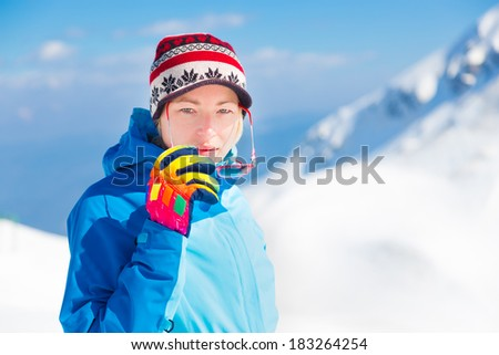 Portrait of active woman outdoors skiing in the Alps Mountains, Triglav natural park, Vogel, Slovenia.