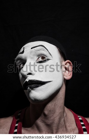 Portrait of actor mime on a black background