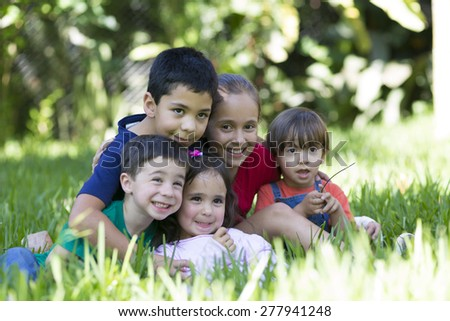 Portrait of Addorable Girls and Boys Outdoors - stock photo