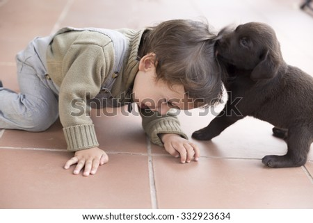 Portrait of Adorable Baby And His Dog At Home - stock photo