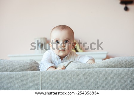 Portrait of adorable baby boy indoor - stock photo