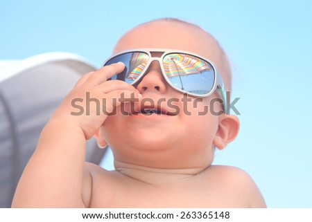 Portrait of adorable baby boy with sunglasses - stock photo