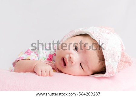 Portrait of adorable baby girl with hat