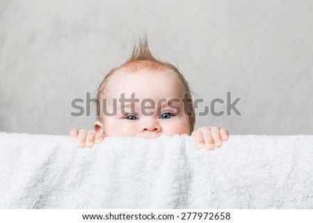 Portrait of adorable baby looking at the camera funny boy 9 months - stock photo