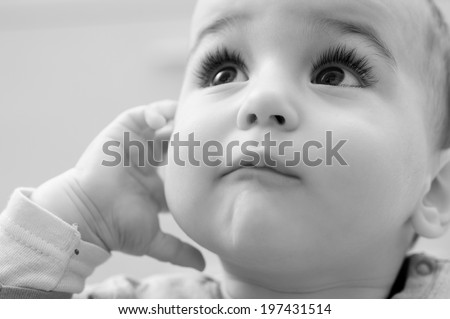 Portrait of adorable baby looking up - stock photo