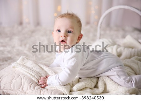Portrait of adorable baby on the floor, close up - stock photo