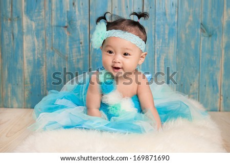 portrait of adorable baby sitting on the blanket  - stock photo