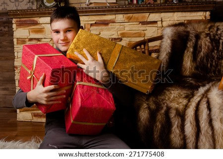 Portrait of adorable boy with giftboxes - stock photo