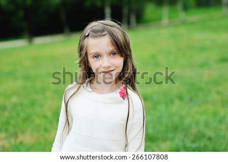 Portrait of adorable brunette kid girl outdoor - stock photo