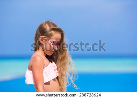Portrait of adorable happy girl in outdoor swimming pool - stock photo
