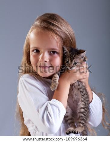 Portrait of adorable little girl and her kitten - stock photo