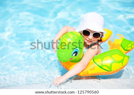 Portrait of adorable little girl at swimming pool