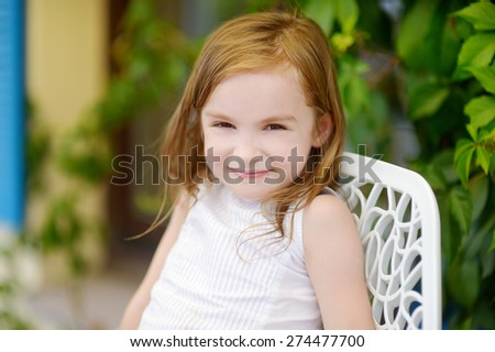 Portrait of adorable little girl outdoors - stock photo