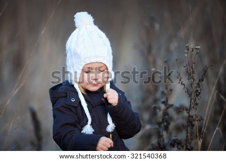 Portrait of adorable little girl wearing parka outdoors on cold winter day - stock photo