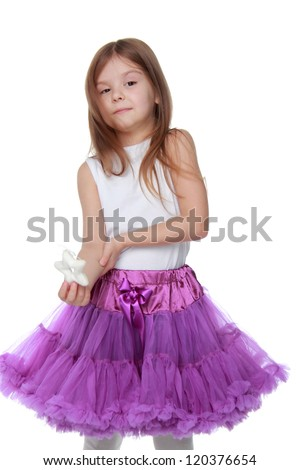Portrait of adorable little girl with little white star on Holiday theme