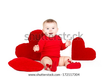 portrait of adorable Little infant girl hugging a large toy heart isolated on white background