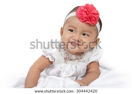 Portrait of adorable smiling baby crawl in bed, isolated on white background - stock photo