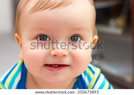 Portrait Of Adorable Smiling Little Boy With Two Teeths
