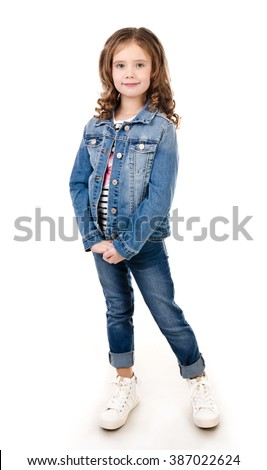 Portrait of adorable smiling little girl in jeans isolated on a white
