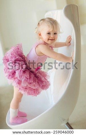 Portrait of adorable smiling little girl in princess dress - stock photo