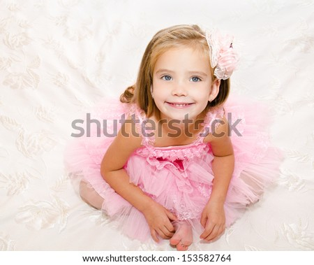 Portrait of adorable smiling little girl in princess dress isolated - stock photo