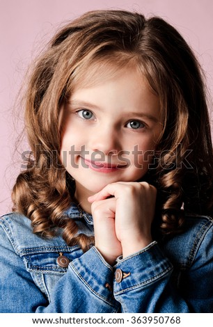 Portrait of adorable smiling  little girl isolated  - stock photo