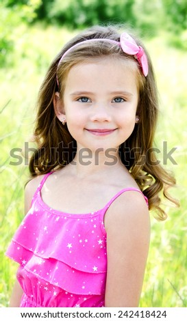 Portrait of adorable smiling little girl outdoor