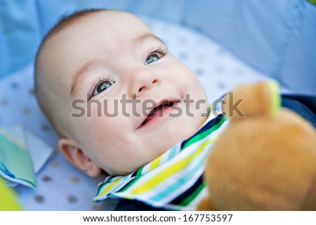 Portrait of adorable smiling newborn baby