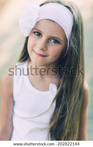 Portrait of adorable 6 years old  girl. Photo processed instagram style - stock photo