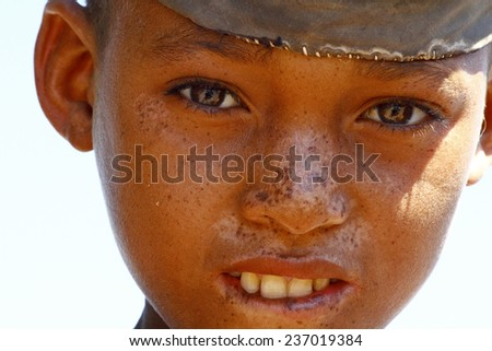 Portrait of adorable young happy boy - african poor child, povernes - stock photo