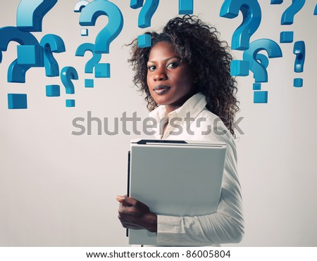 portrait of adult businesswoman and blue question mark - stock photo