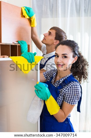 Portrait of adult european people in overalls with supplies doing clean-up