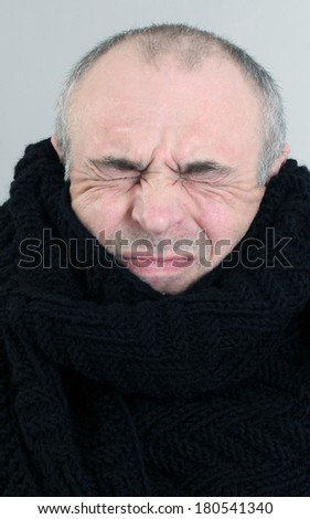 portrait of adult male eyes closed gray background