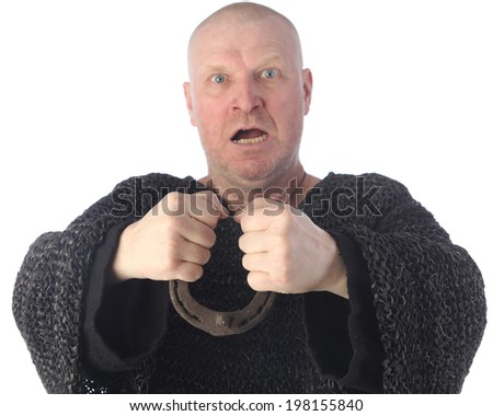 portrait of adult white men in chain armor trying with great effort to straighten a horseshoe on white background studio