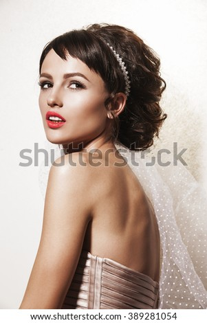 Portrait of affectionate brunette woman. Beautiful bride with wedding makeup, hairdo and wedding decorations. Wedding ideas and bridal style.