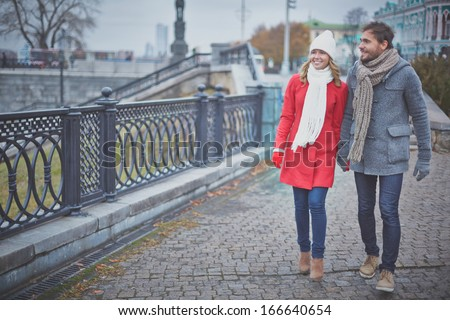 Portrait of affectionate couple taking a walk in the city - stock photo